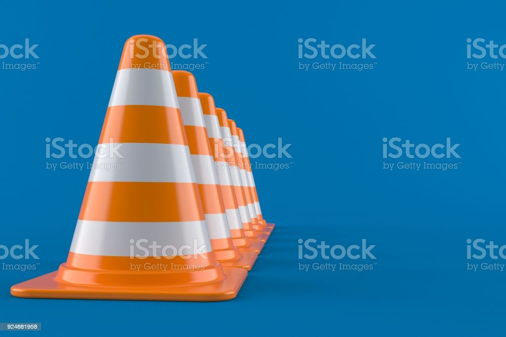Traffic cones in a row isolated on blue background