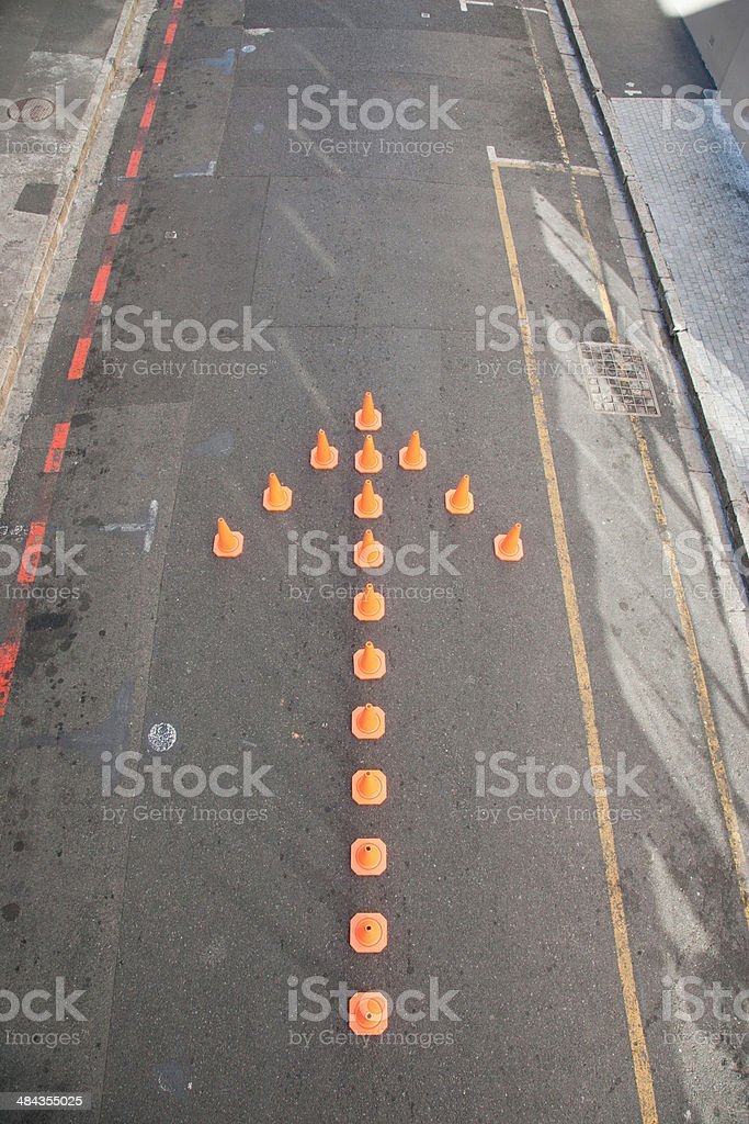 Traffic cones in arrow-shape stock photo