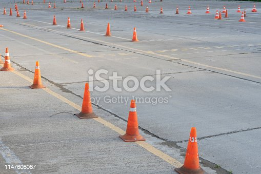 istock Traffic cones in driving school or road. Close up 1147608087