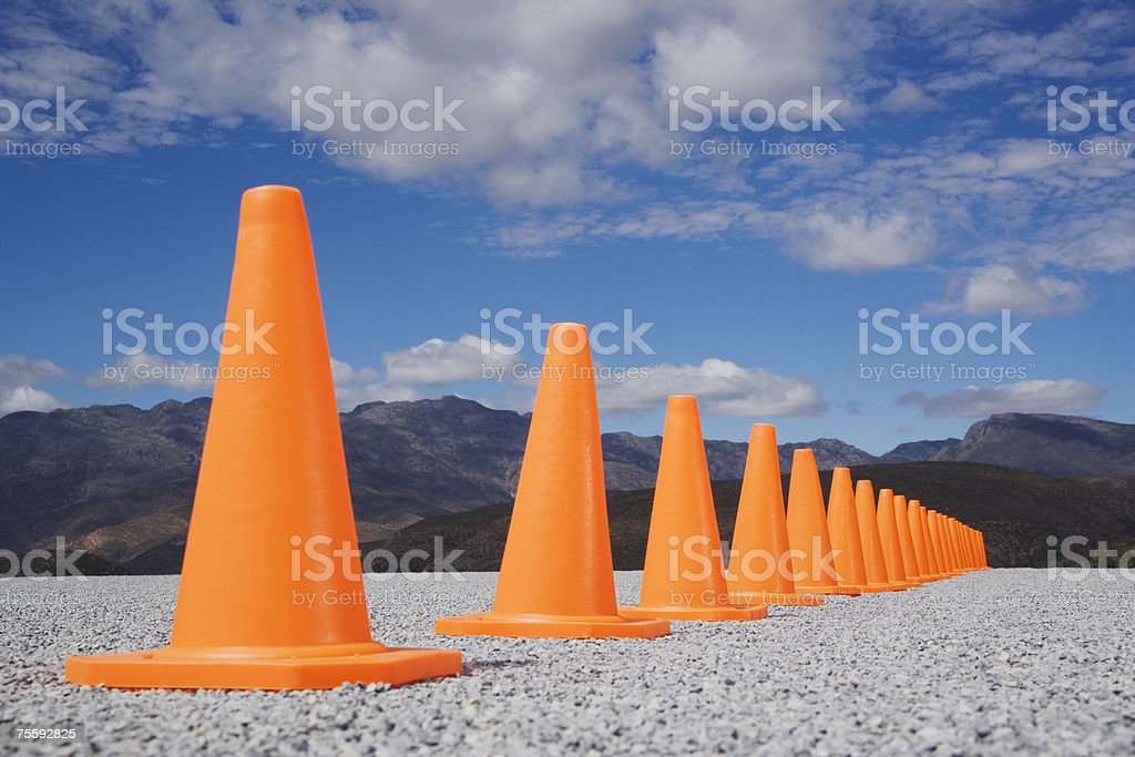 Traffic cones in line outdoors ground level view stock photo