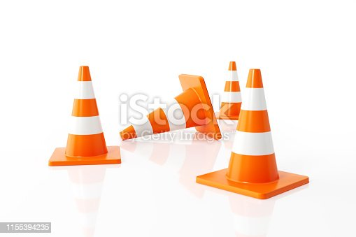 Orange colored traffic cones on white background. Horizontal composition with  copy space. Clipping path is included.