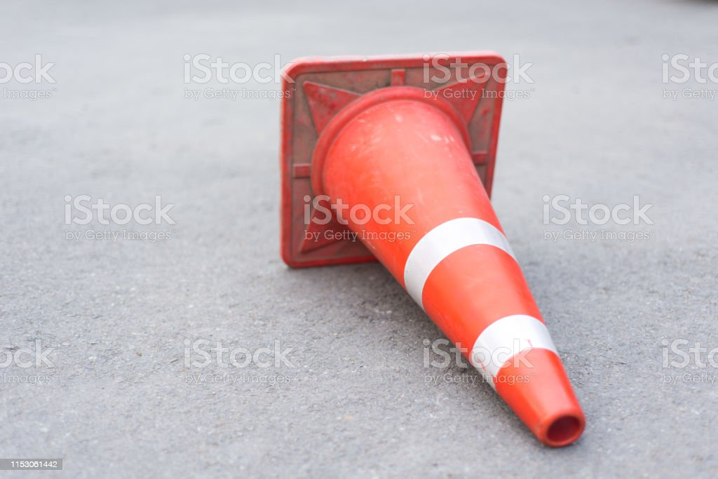 Traffic cones placed on the street floor.