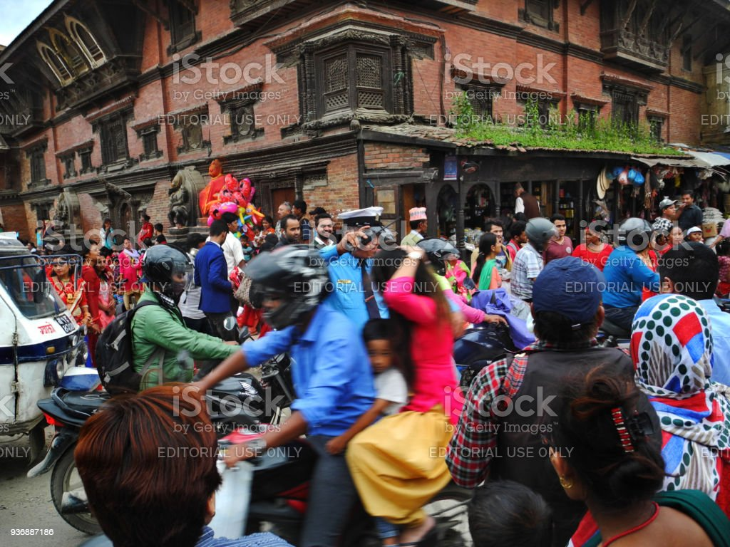 traffic control by single police officer in large group of nepalese people at Thamel Kathmandu stock photo