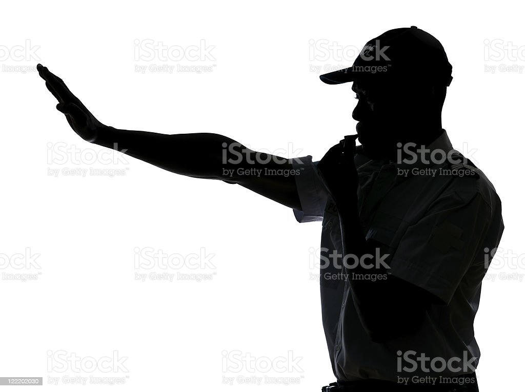 Traffic cop making stop gesture stock photo