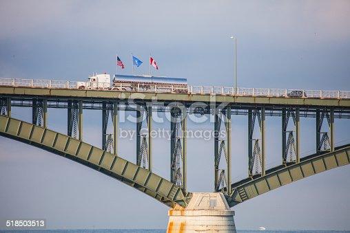istock Traffic Crossing Peace Bridge at United States Canada border flags 518503513