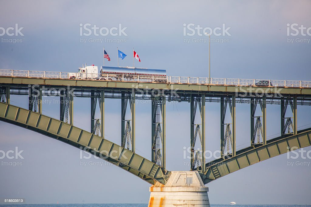 Traffic Crossing Peace Bridge at United States Canada border flags stock photo