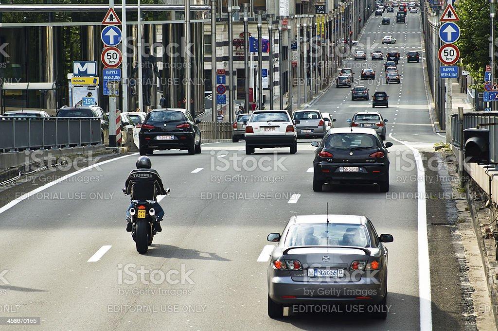 Traffic down Rue De La Loi in Schuman district, Brussels royalty-free stock photo