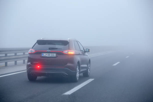 Traffic during thick fog stock photo