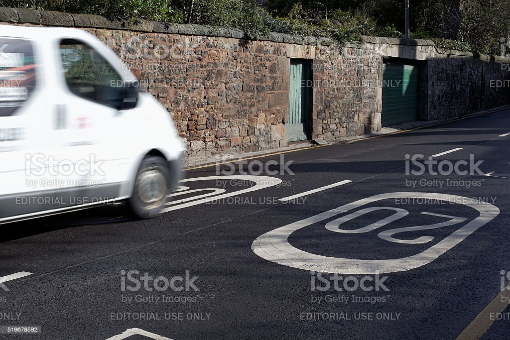 Traffic in a 20mph restricted zone residential area in the UK stock photo