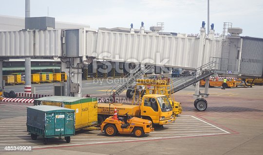 Bangkok, Thailand - July 2, 2015: Some vehicles running inside Don Muang International Airport. Don Muang is a regional commuter flight hub in Bangkok, Thailand.