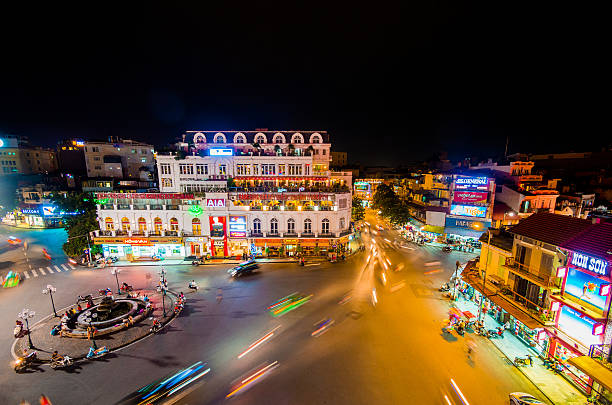 Traffic in Hanoi, Vietnam View of the traffic in Hanoi, Vietnam in front of the City View Cafe building at night. hanoi stock pictures, royalty-free photos & images