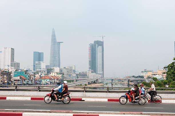 traffic in hcmc, vietnam - motorbike, umbrella stock photos and pictures