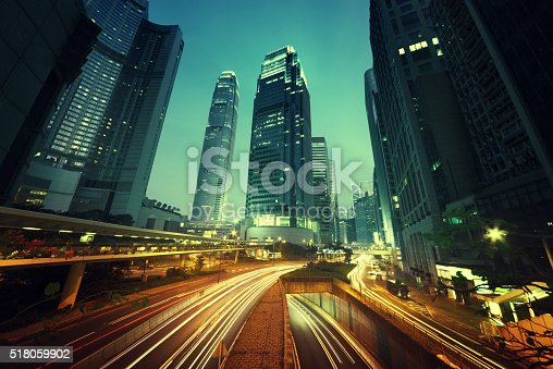 820883024 istock photo traffic in Hong Kong at sunset time 518059902