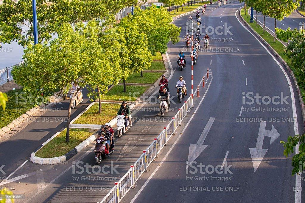 Traffic in new Vo Van Kiet Boulevard in Saigon stock photo
