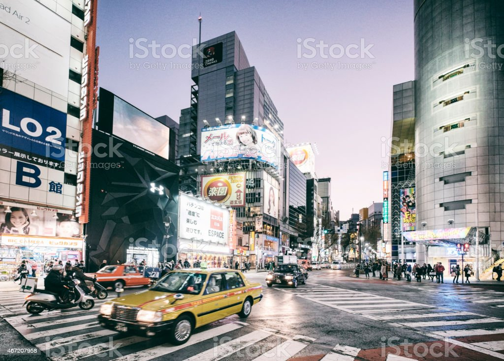 Traffic in Shibuya Japan at Night stock photo