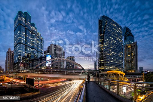 istock Traffic in the business district at night 840733592