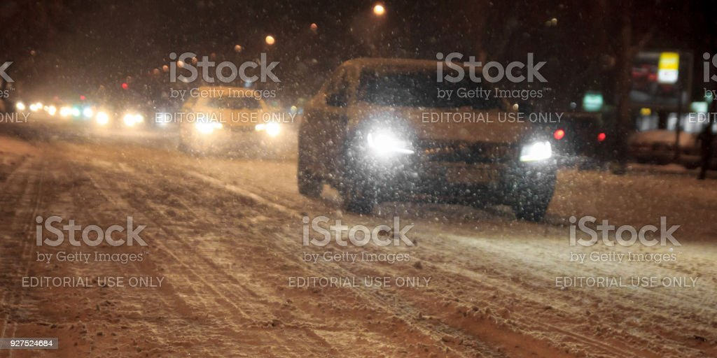 Traffic in the city cars bad weather and snow fall blizzard stock photo
