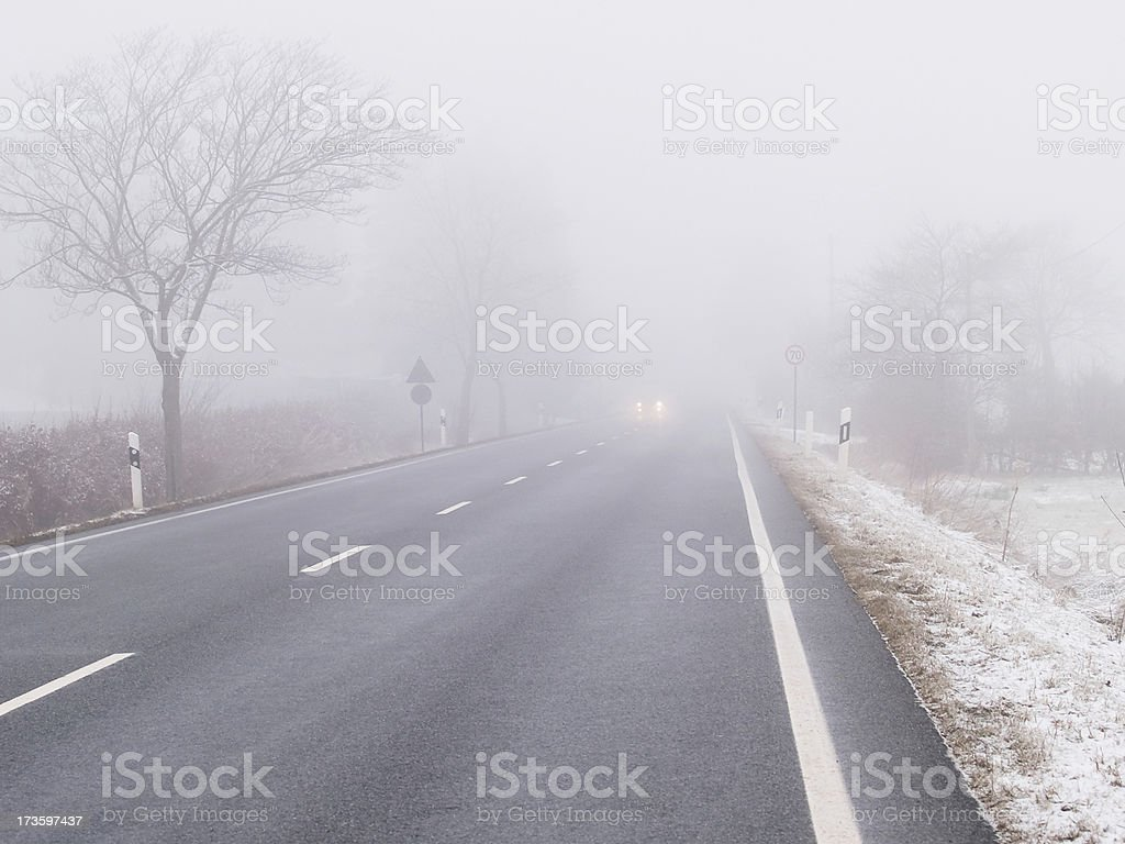 Traffic in the fog. royalty-free stock photo