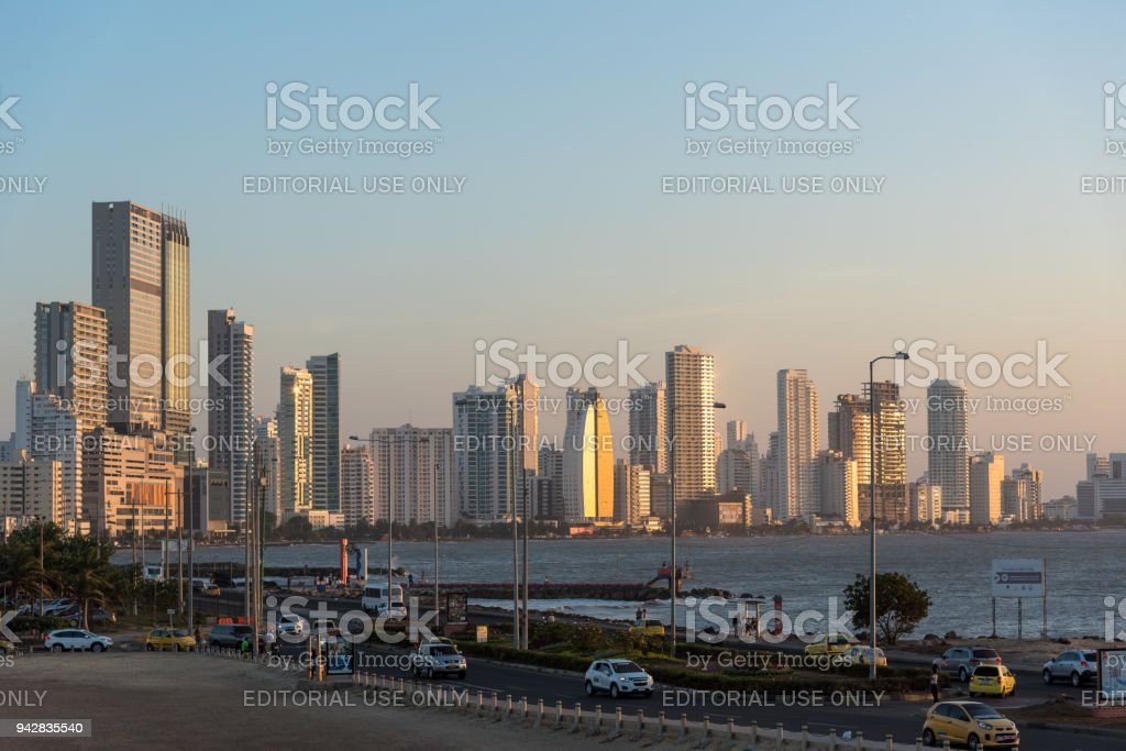 Traffic in the streets of Cartagena with modern city in the background when attracting. Cartagena Colombia. stock photo