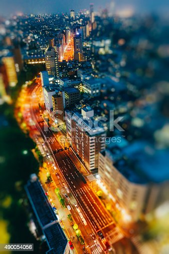 Vehicles passing on the streets in Tokyo, Japan in the night.