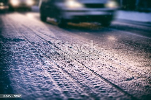 Cars on a snowy road at night