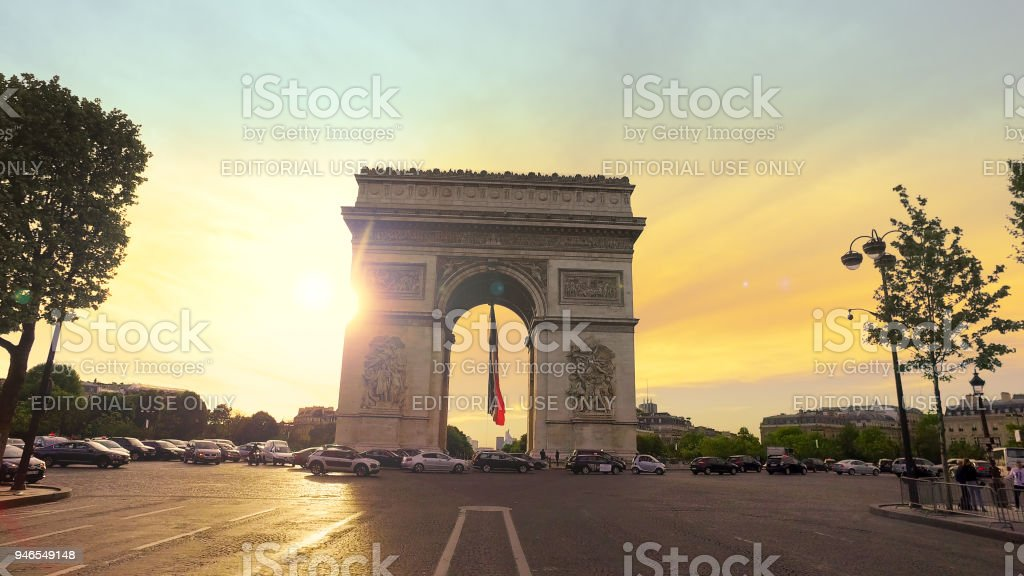 Traffic jam at circle at Arc de Triomphe at sunset. It  is one of the most famous monuments in Paris, in the centre of the Place Charles de Gaulle stock photo