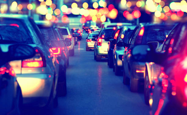 traffic jam at night, view from inside the car - traffic stock photos and pictures