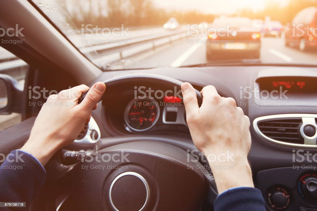 traffic jam, driving car on highway, close up of hands stock photo