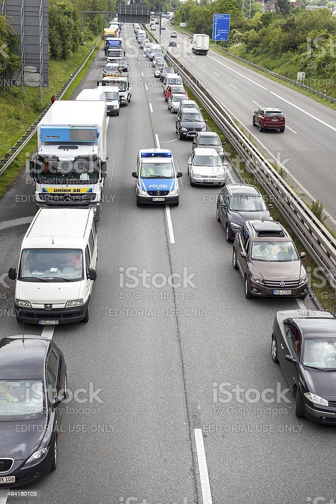Traffic jam, German police car royalty-free stock photo