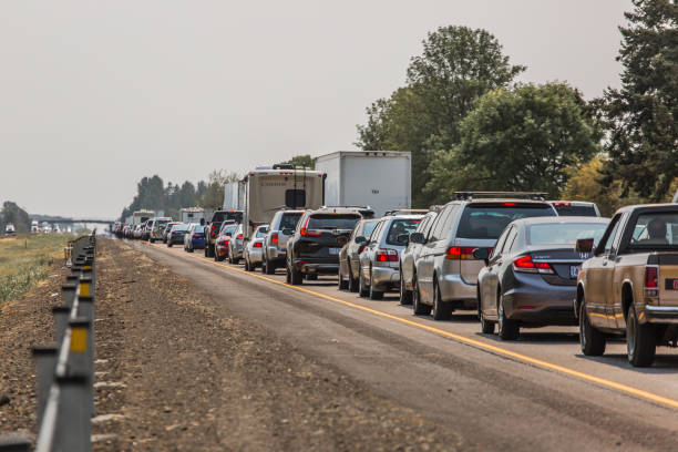 traffic jam in a highway - traffic stock photos and pictures