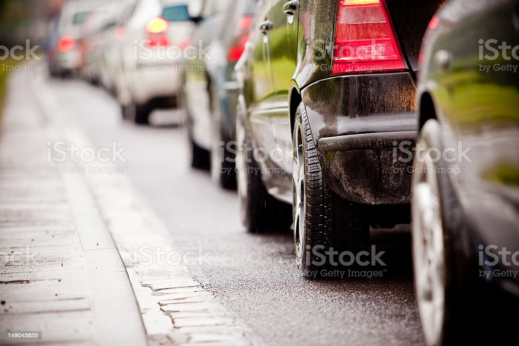 Traffic jam in flooded highway cause rain stock photo