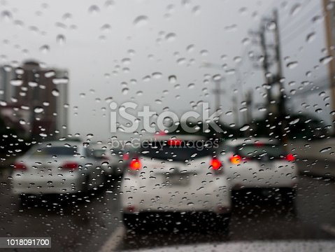 1054750504 istock photo Traffic jam in rainy day with raindrops on car glasses 1018091700