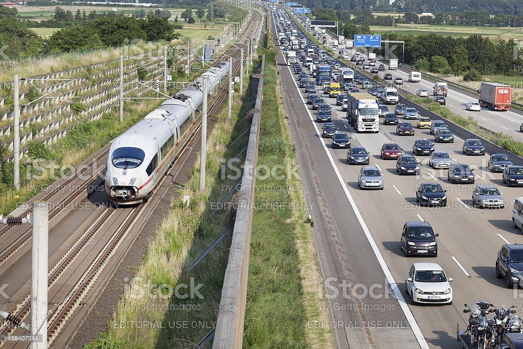 Traffic jam on german Autobahn A3 and High Speed train royalty-free stock photo