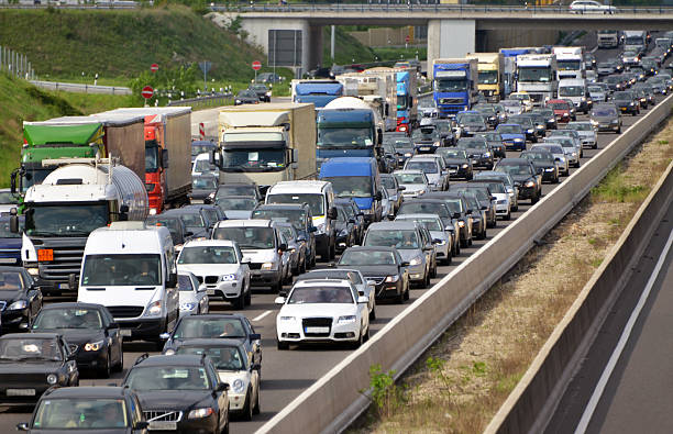 traffic jam on highway traffic jam during rush hour on multi-lane motorway traffic jam stock pictures, royalty-free photos & images