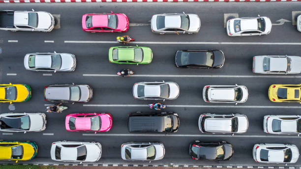 Traffic Jam on multilane road. Aerial drone photograph of traffic jam in metropolis city with lots of cars qued on lanes. car stock pictures, royalty-free photos & images
