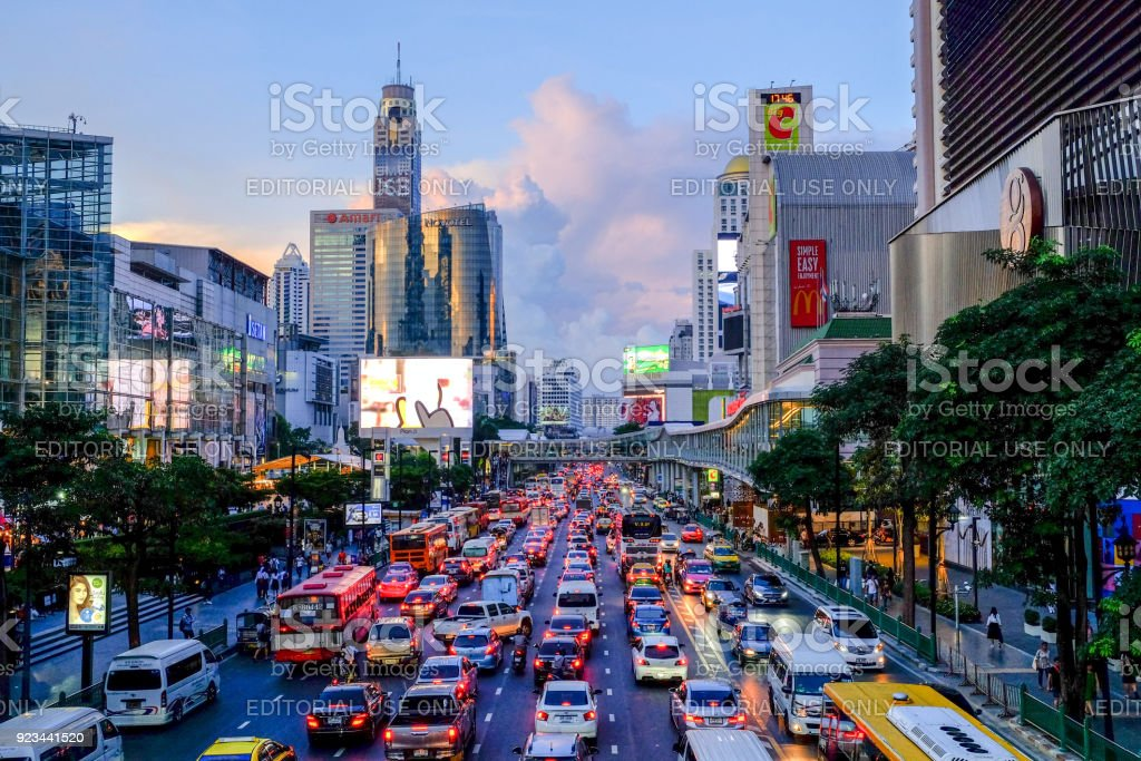 Traffic jam on Ratchadamri Rd, in front of Central World and BigC supercenter in the evening after work. stock photo