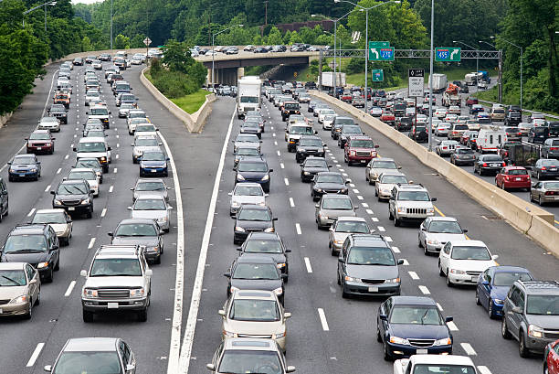 Traffic Jam Traffic Jam on Capitol Beltway, Washington DC on a cloudy overcast day. traffic stock pictures, royalty-free photos & images