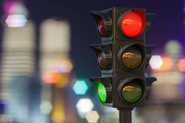 Traffic light closeup in the night city, 3D rendering stock photo