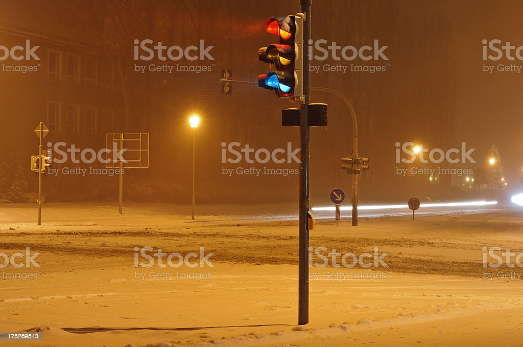 Wintry traffic light crossing in the city.