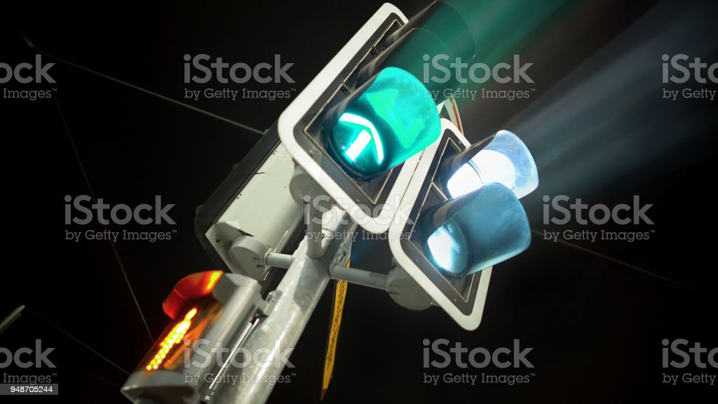 Traffic light green for cars and red for people, transportation, urban life stock photo