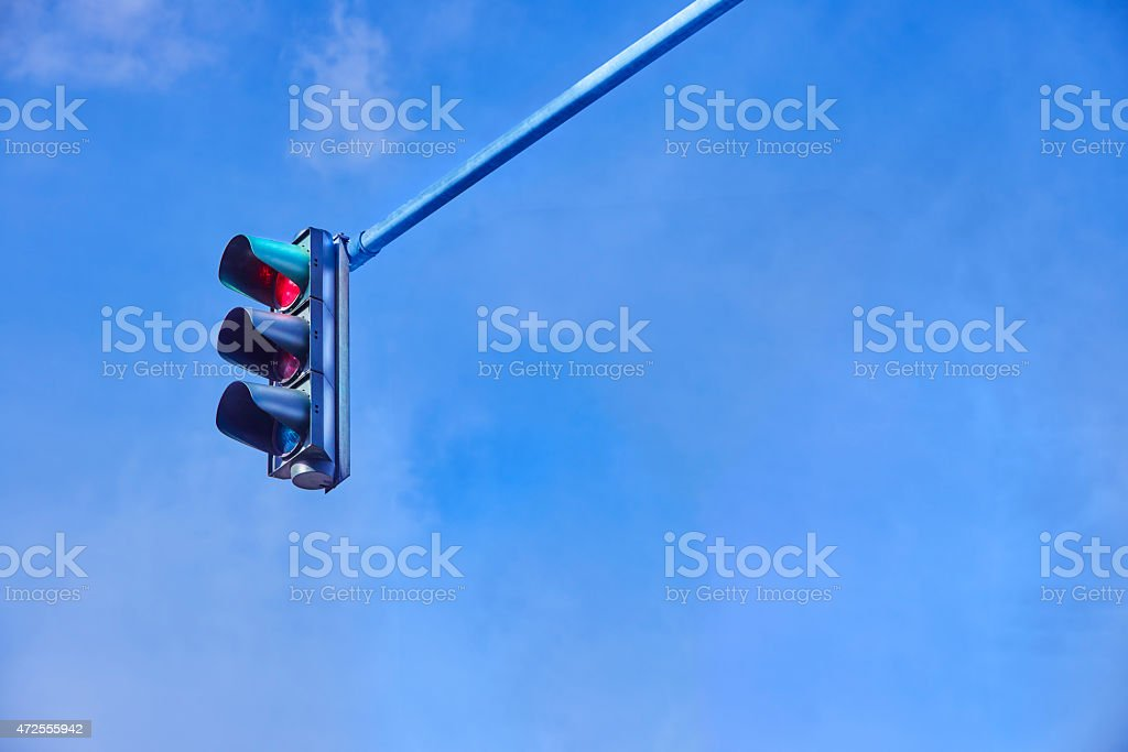 Traffic light on blue sky with red light stock photo
