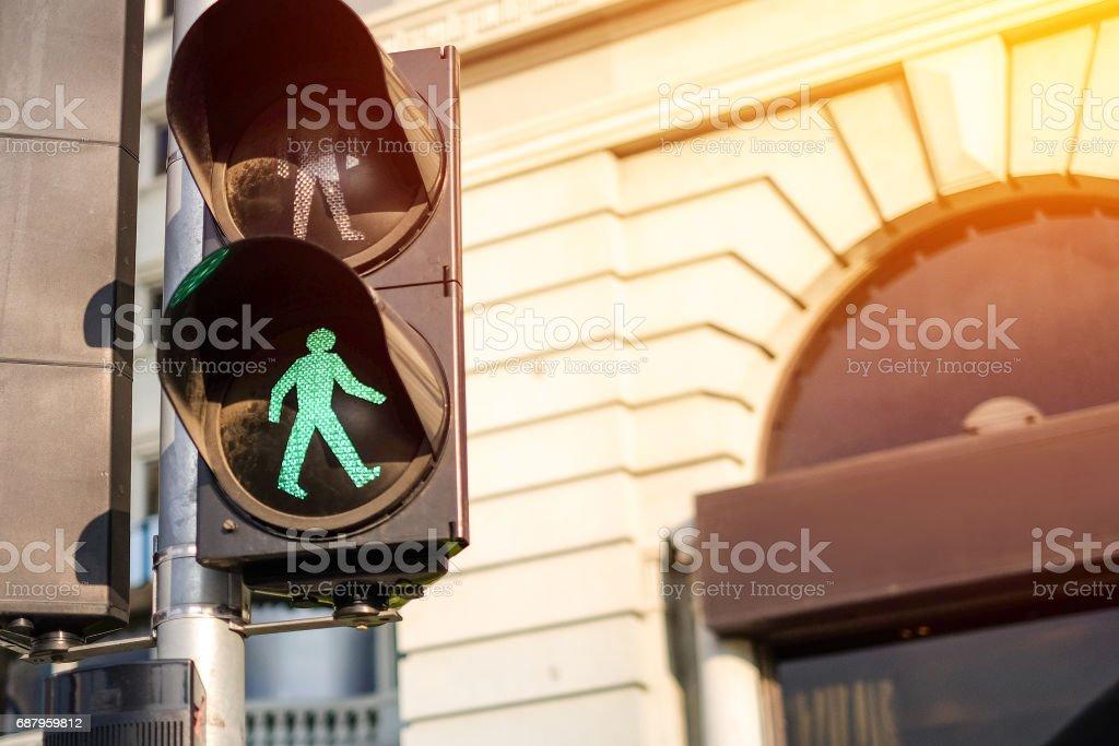 Traffic light on green in sunlight stock photo