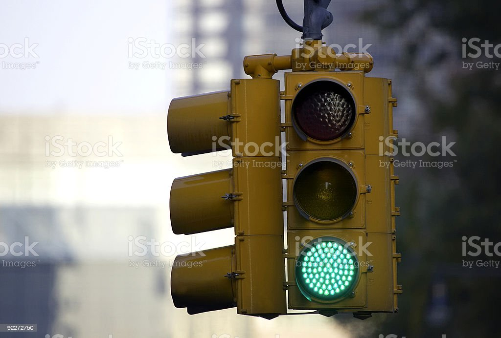 Traffic light on green stock photo