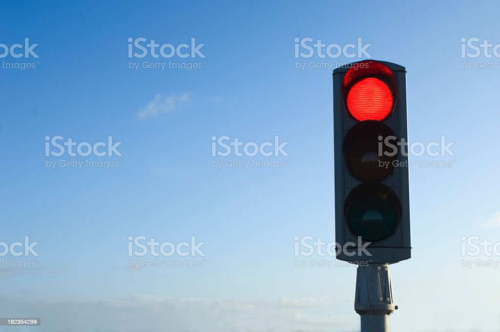 Traffic Light on Red Isolated Against Blue Sky stock photo