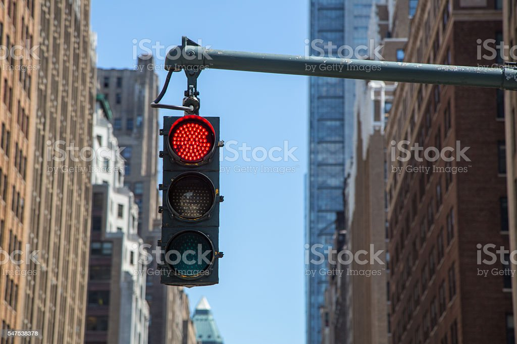 Traffic light on the background of skyscrapers in New York stock photo