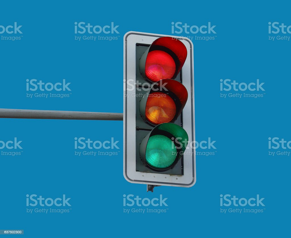traffic light At a traffic light the three colors light up red, yellow and green at the same time. Blue Stock Photo