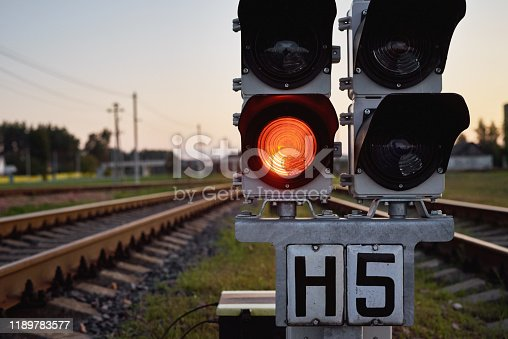 Traffic light show red signal on railway, close up