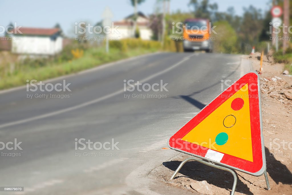 Traffic light warning sign on roadside, road works ahead stock photo