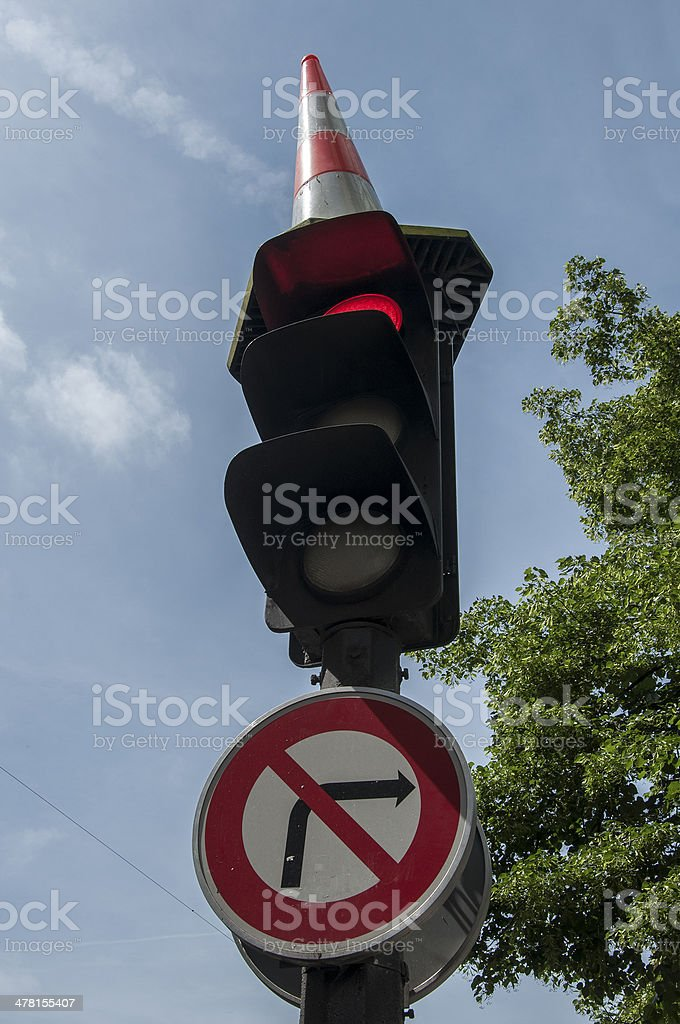 Traffic light with hat stock photo