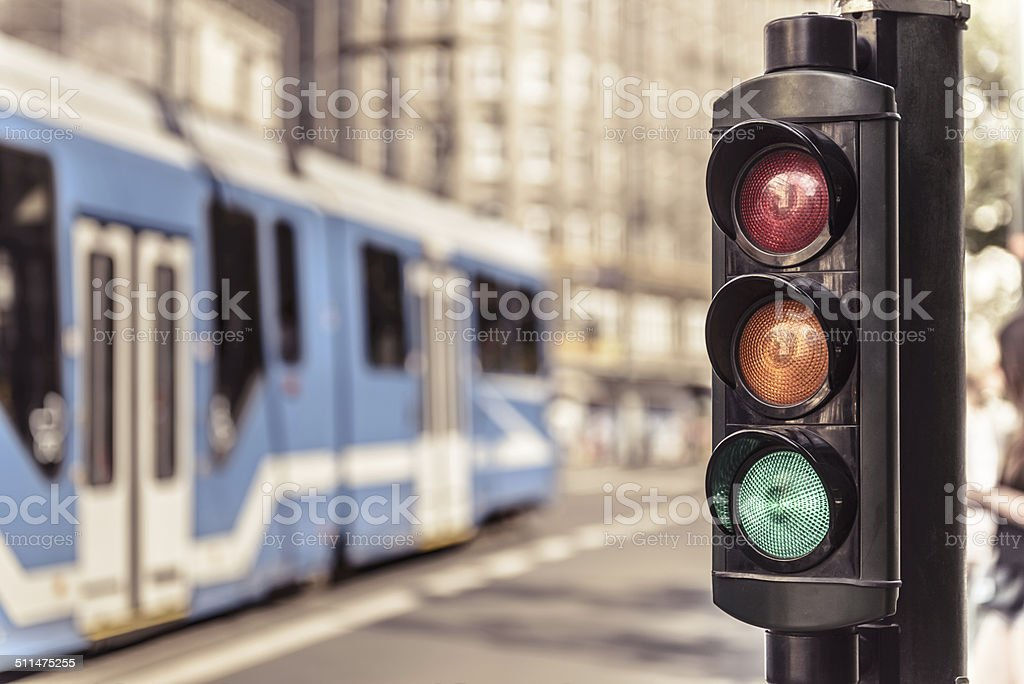 Traffic lights and city tram in Krakow, Poland. stock photo